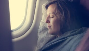 How to Sleep on a Plane: 11 Tips for Better Sleep on Long Haul Flights
